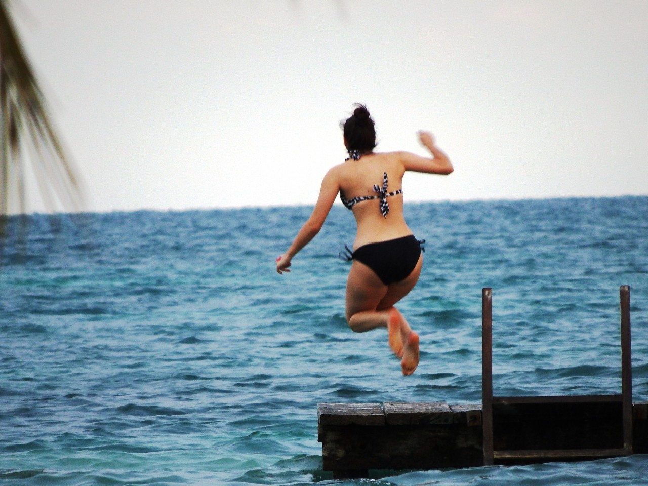 Jump into the warm waters of Belize at St. George's Caye Resort